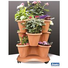 Set Composto Da 3 Vasi Sovrapponibili In Polipropilene Color Terracotta E 1 Sottovaso Con Ruote